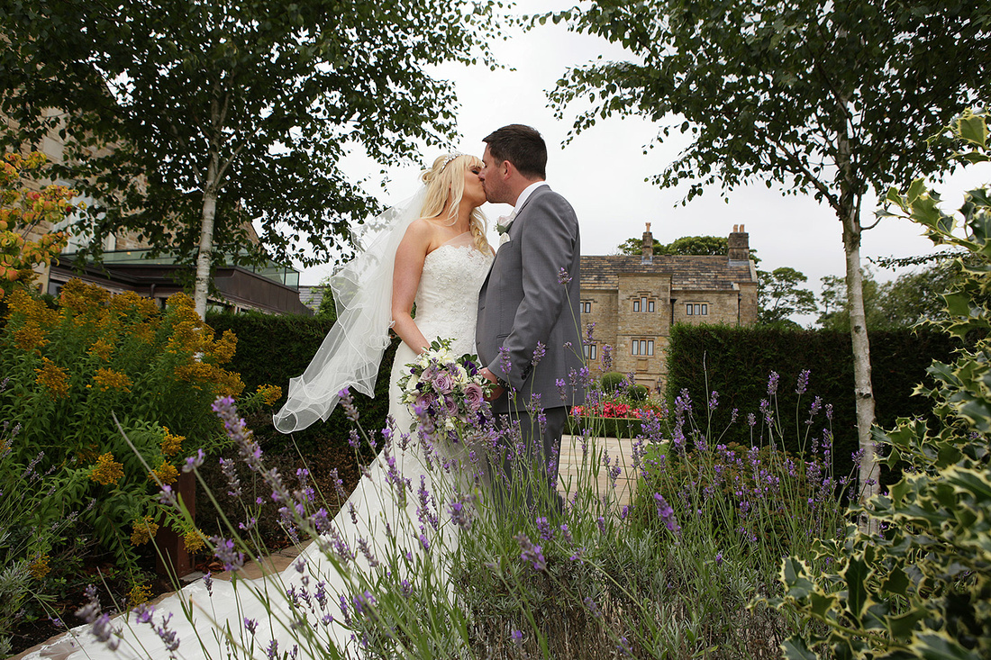 newly weds kissing each other as they celebrate their wedding at various wedding venues throughout cheshire