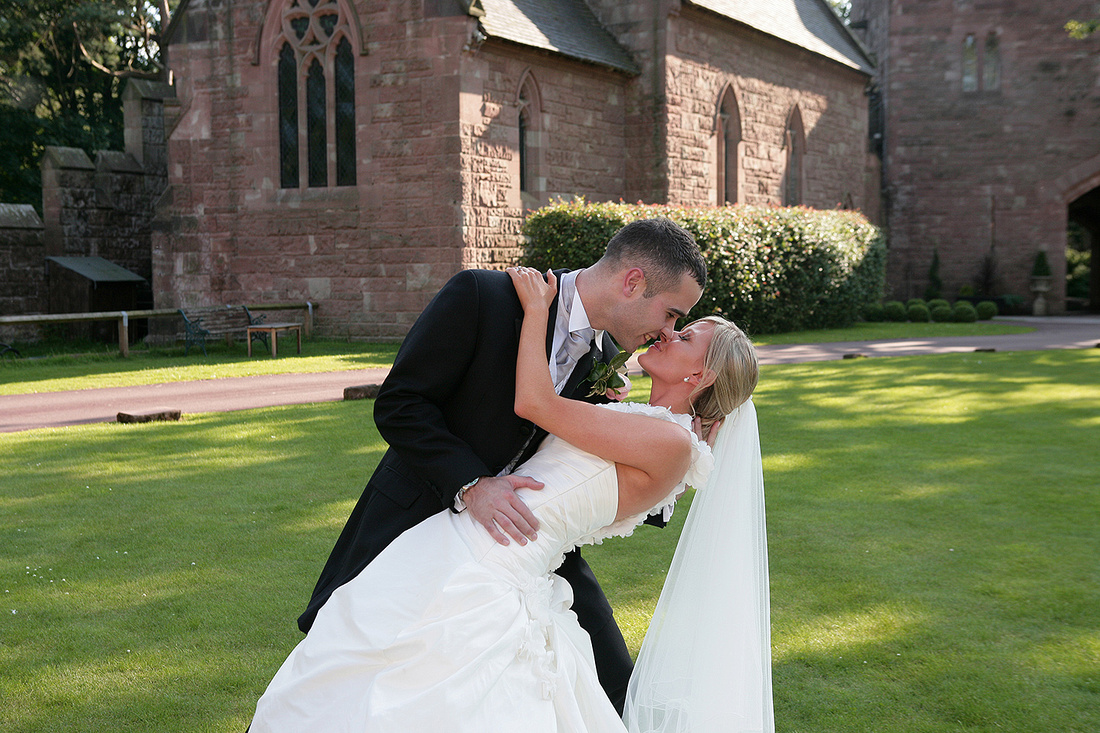 romantic kiss on their wedding day