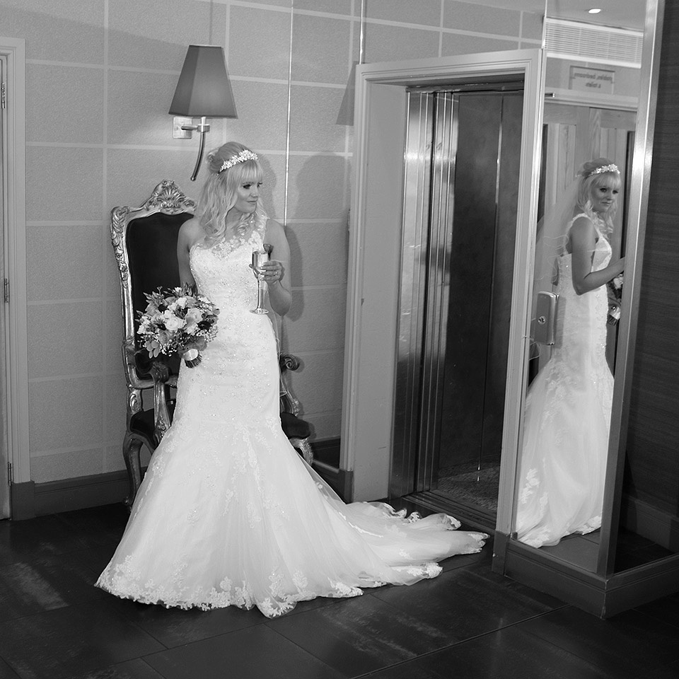 bride last minute check of her wedding dress