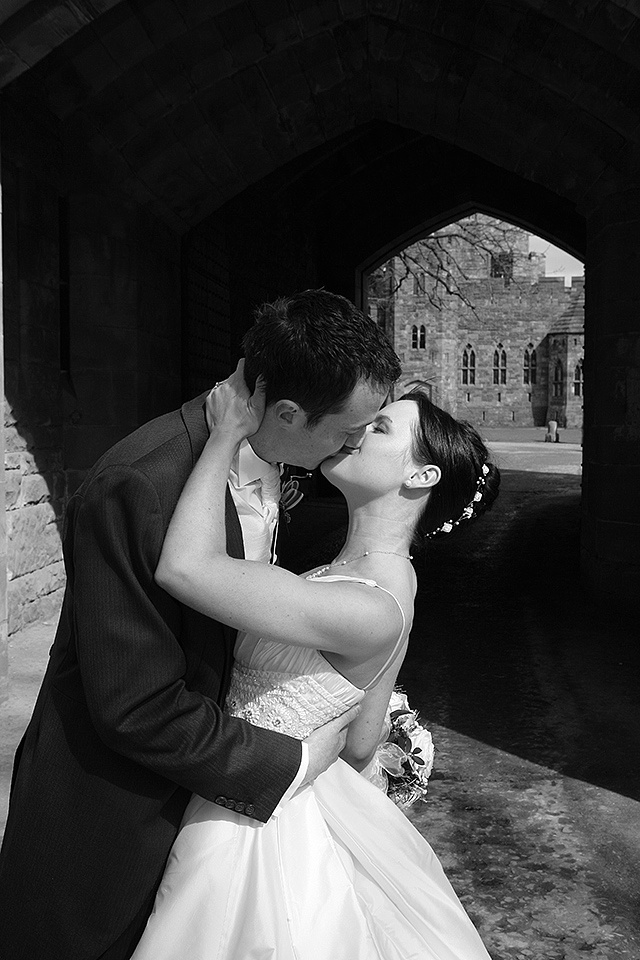 the bride and groom kissing romantically