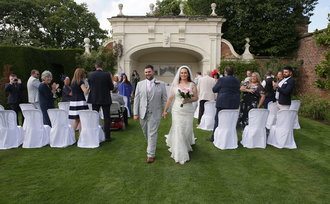 wedding ceremony outside at arley hall