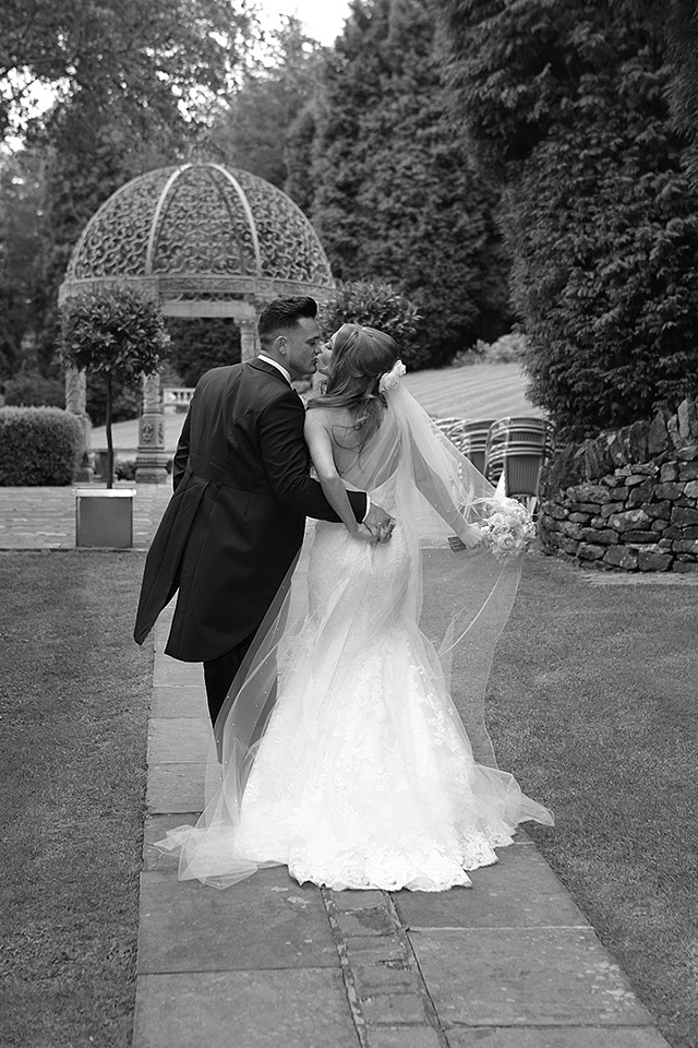 bride and groom's kissing during their wedding at cheshire wedding venues